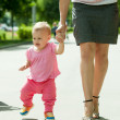 Toddler walking on road - Stock Photo
