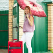 Woman with luggage — Stock Photo #8139780