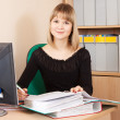 Businesswoman with documents working in office — Stock Photo #8139807