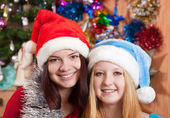 Girls in Christmas hats — Stockfoto