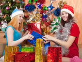 Girls with christmas gifts — Stock Photo