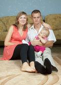 Parents with baby in home interior — Stock Photo