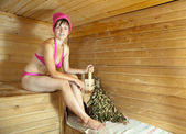 Girl is steamed in sauna — Stock Photo