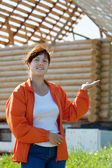 Happy woman in front of building home — Stock Photo