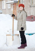 Woman with shovel — Stock Photo