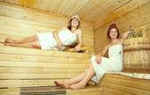 Women girl on bench in sauna — Stock Photo