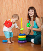 Mother plays with baby — Stock Photo