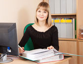 Businesswoman with documents working in office — Stock Photo