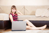 Woman looking to laptop — Stock Photo