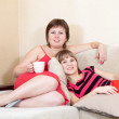 Relaxed women lying on sofa — Stock Photo #8140052