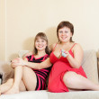 Women having fun by television — Stock Photo #8140058