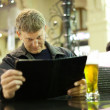 Mature man reading menu card — Stock Photo #8140082