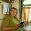 Mature man  in sleeper train — Stock Photo
