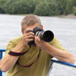 Male photographer — Stock Photo #8140094