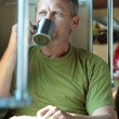 Man drinks tea  in sleeper train - Stock Photo
