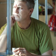 Man looking to window in sleeper train — Stockfoto