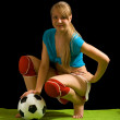Female soccer player with ball — Stock Photo
