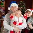 Family of three celebrating Christmas — Stock Photo #8140668