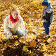 Stock Photo: Womwith son planting tree in autumn