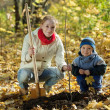Family planting tree in autumn — Stock Photo #8140726