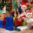 Mother and little son with Christmas gifts — Stock Photo #8140763