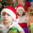 Little boy  in Christmas hat - Foto Stock