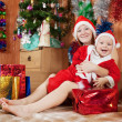 Boy with mother celebrating Christmas — Stock Photo #8140796
