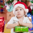 Royalty-Free Stock Photo: Little boy with Christmas gift
