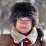 Woman wearing fur cap — Stock Photo #8140868