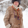 Mature woman in wintry forest — Stock Photo #8140893
