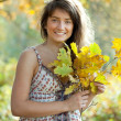 Girl with oak leaves posy — Stock Photo