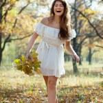 Happy girl in autumn park — Stock Photo #8141202
