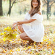 Long-haired girl in autumn — Stock Photo