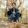 Stock Photo: Happy girl in autumn park