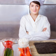 Cook woman with ingredients for sushi rolls — Stock Photo