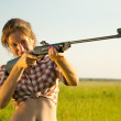 Girl aiming pneumatic rifle — Photo #8141371