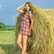 Girl on hay — Stock Photo