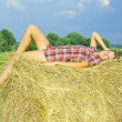 Country girl on hay — Stock Photo