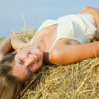 Girl enjoying on hay - Stock Photo