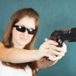 Stock Photo: Girl aiming black gun