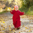Happy toddler in autumn park — Stock Photo