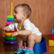 Stock Photo: Toddler sitting on potty