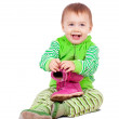 Toddler child holds shoes — Stock Photo