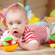 Happy baby with baby's things — Stock Photo