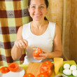 Stock Photo: Womcooking farci tomato