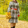 Happy senior woman  in autumn - Stock Photo