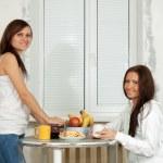 Smiling women have tea — Stock Photo