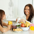 Two smiling women have tea — Stock Photo #8142328