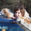 Stock Photo: Womnear her car in winter road