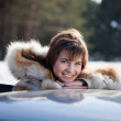 Stock Photo: Portrait of happy womnear her car